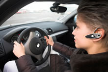 Call 511, Safety Tips - woman on Bluetooth device photo