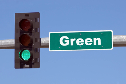 Go Green section - green traffic light and street sign photo
